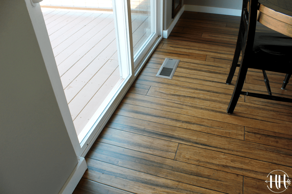 Discoloration of wood flooring next to a sliding glass door.