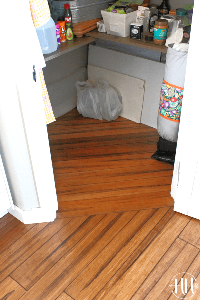 Pantry floor with diagonal wood floor planks.