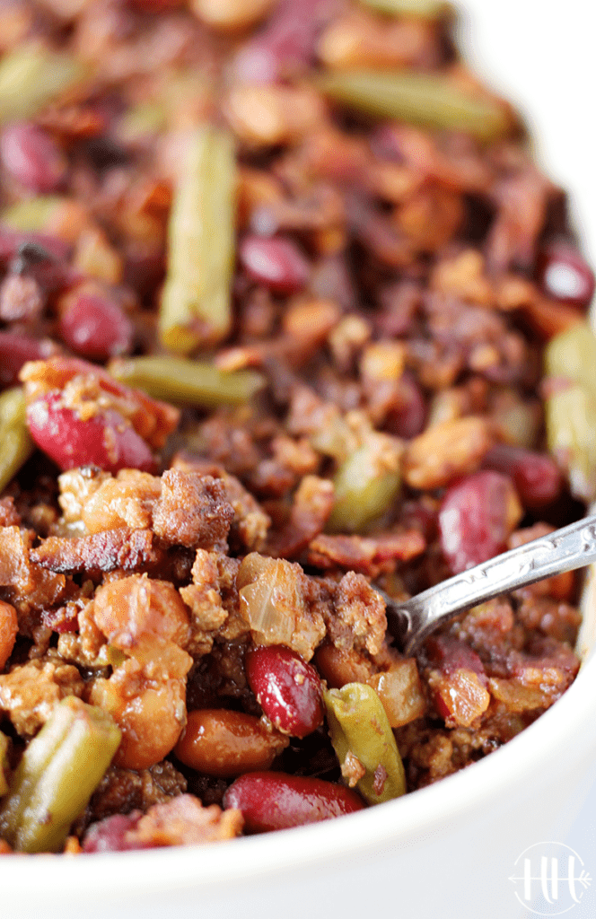The BEST Calico Beans Bake (Cowboy Beans)| This gluten free and dairy free recipe with hamburger and bacon is the perfect BBQ side dish. Use ground beef, beans, simple spices and healthy coconut sugar. I bake this recipe in the oven, but you can use a crockpot or slow cooker too! You can easily make this simple meal vegetarian by omitting the meat. Bring this summer side dish to your next barbecue (4th of July food & Memorial Day) for a crowd or eat this casserole at home for an easy dinner!