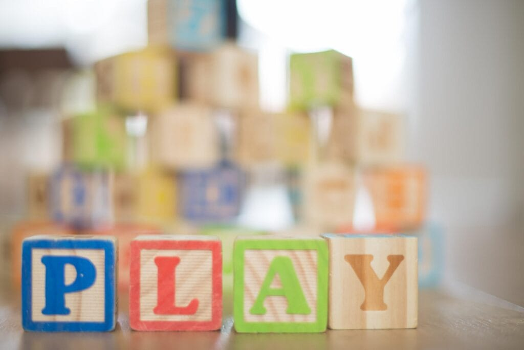 Blocks that spell, PLAY, for a play cafe article.