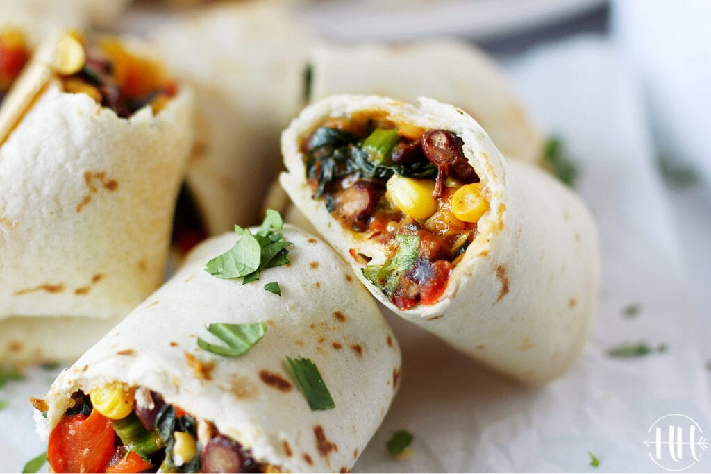 Air fryer vegan southwest egg rolls recipe bursting with fresh produce, beans, and plant based cheese.