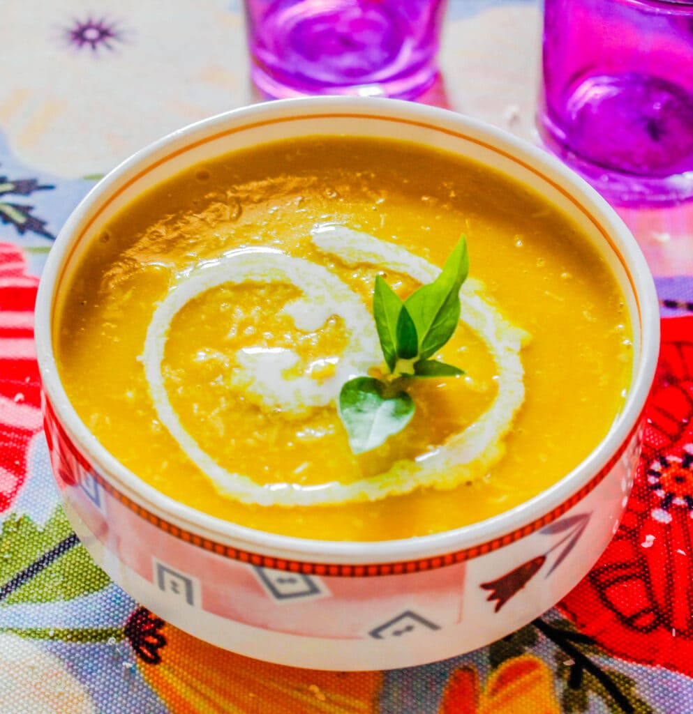 Vegetarian Butternut Squash Soup in an eclectic bowl garnished with basil.
