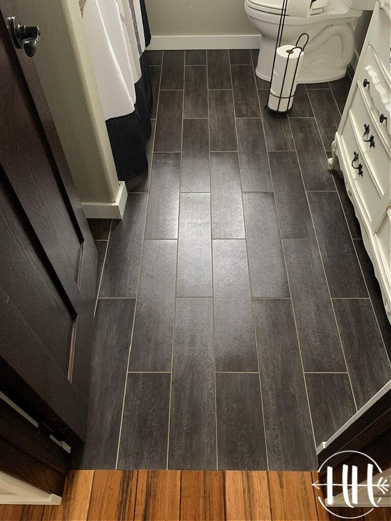 Black Luxury Vinyl Plank Tile Flooring in a bathroom.