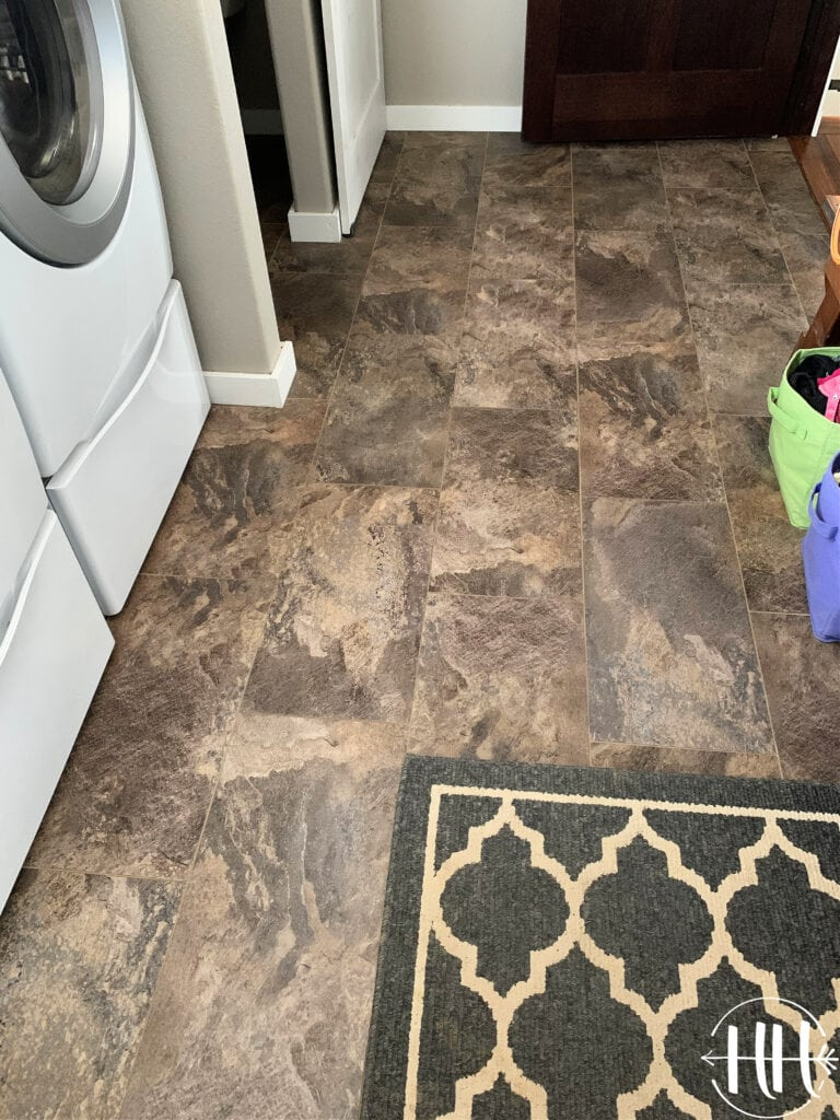 Luxury Vinyl Plank Tile Flooring finished and sparkling a laundry room.