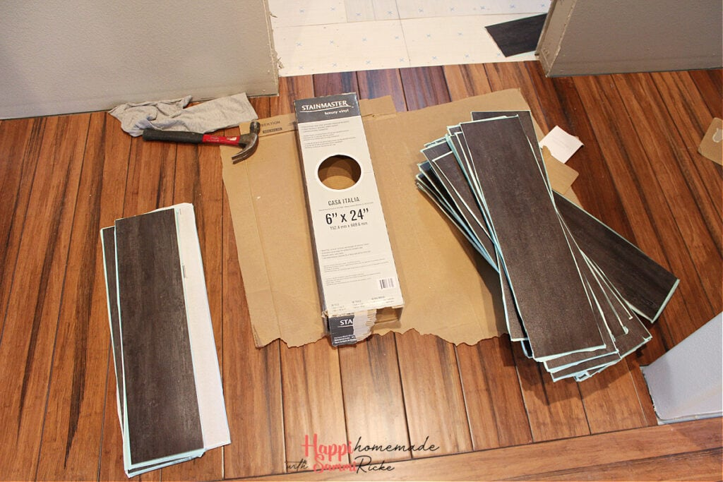 """Stainmaster Casa Italia Luxury Vinyl Tile 6"""" x 24"""" taken out of the box and ready to install."""
