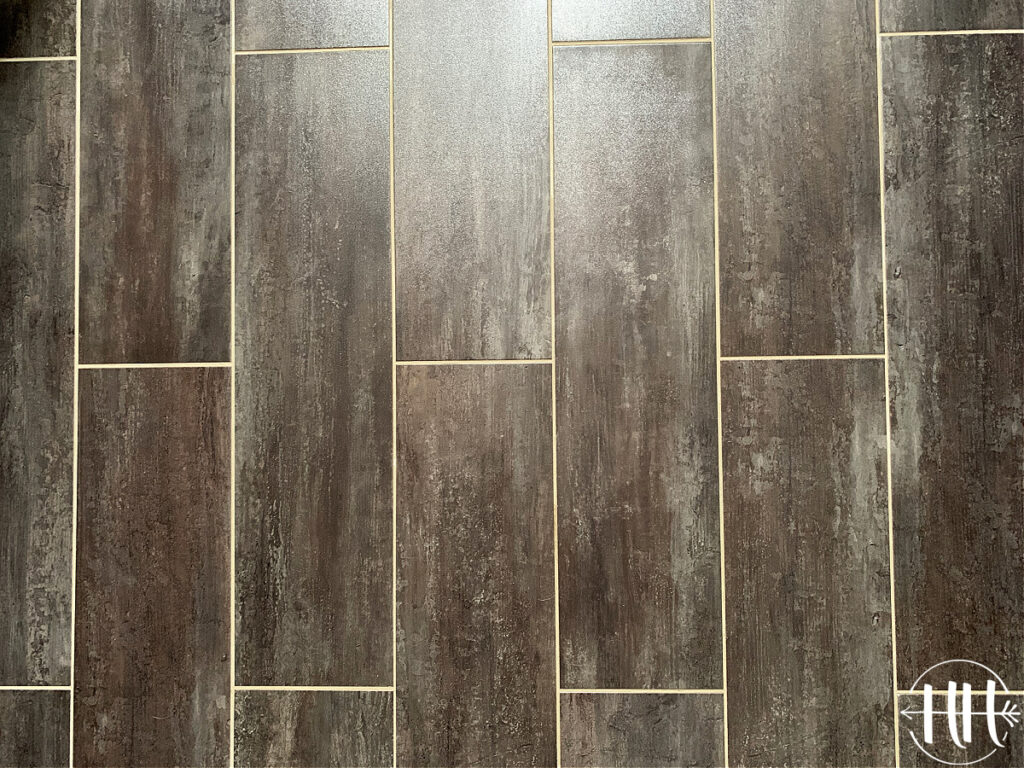 Stainmaster Casa Italia Luxury Vinyl Tile with Saddle Grey grout.