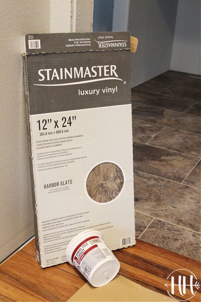 "Stainmaster Luxury Vinyl Tile in Harbor Slate 12"" x 24"" in it's box."