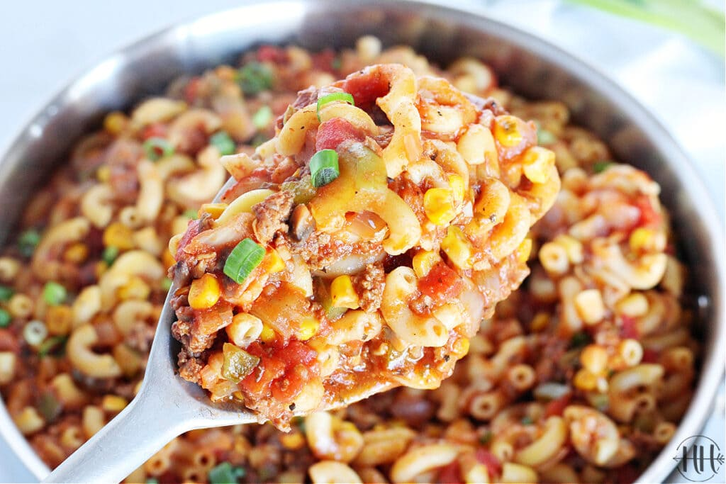 Spoonful of veggie packed ground meat casserole.