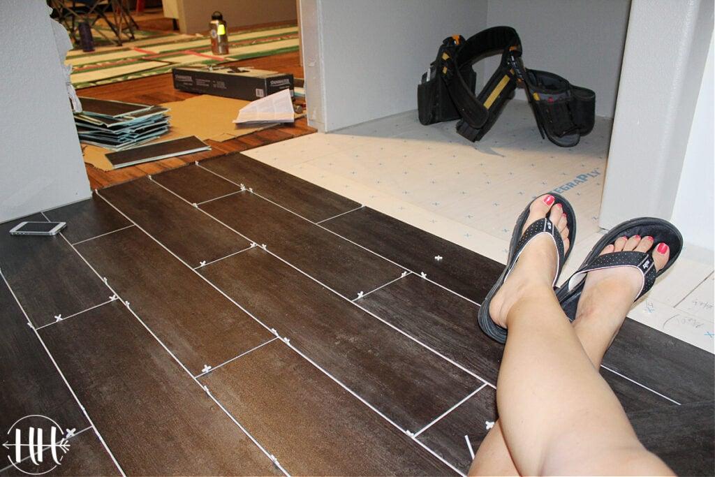"""Luxury vinyl plank flooring with 1/8"""" spacers in a bathroom."""