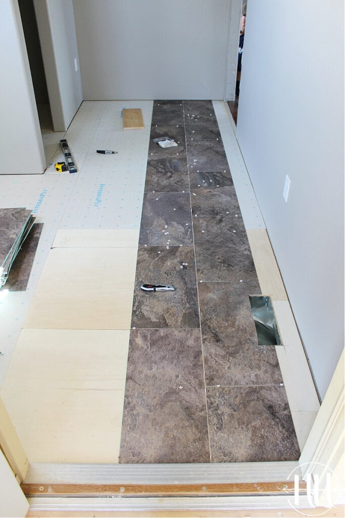 The first two rows of Luxury Vinyl Plank Tile Flooring in a mud room.