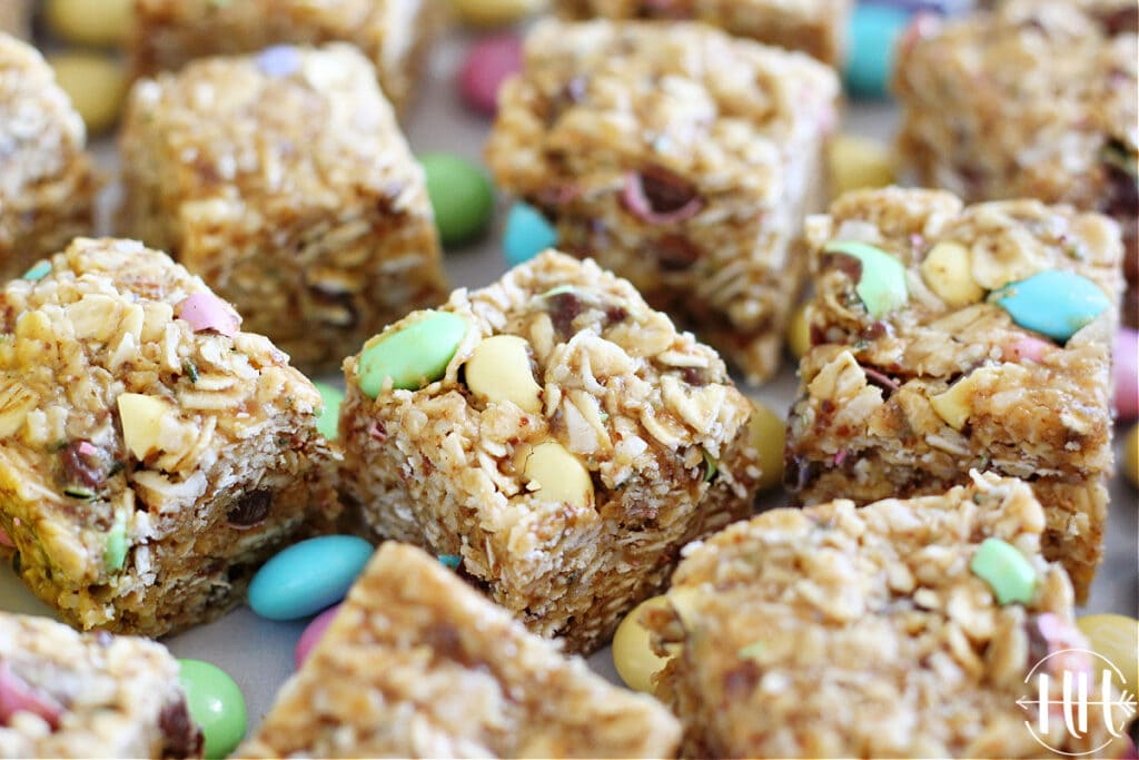 Easter M&M's Energy Bars cut into squares surrounded by pastel candies.