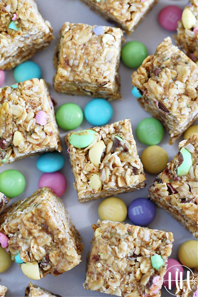 Overhead shot of Easter M&M's Energy Bars surrounded by pretty and festive colored candies.