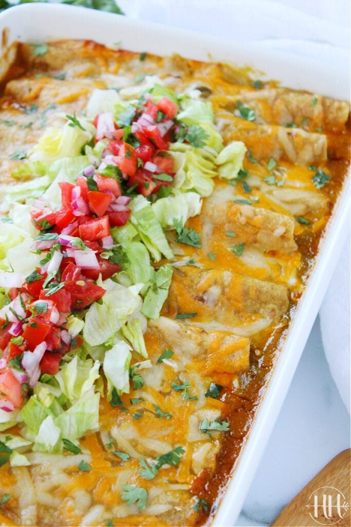 Up close photo of a pan of beef enchiladas.