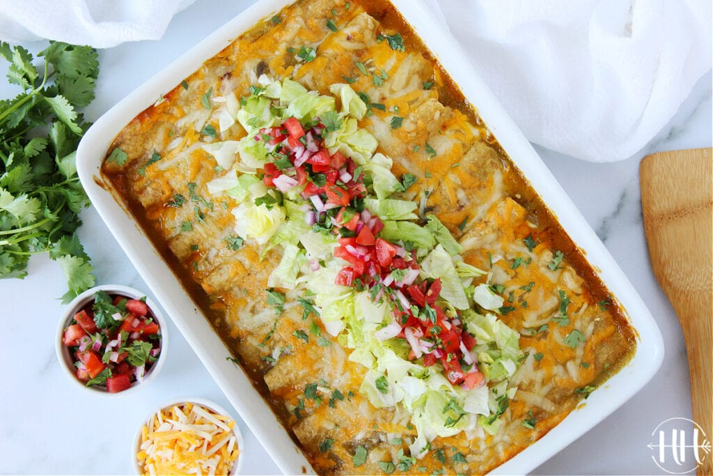 Overhead shot of a pan of healthy enchiladas in a white pan.