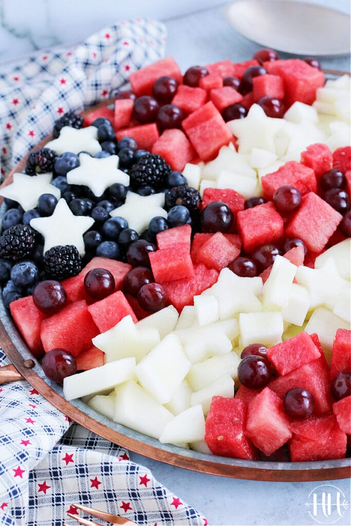 A fruit tray for Labor Day with red white and blue fruit salad.