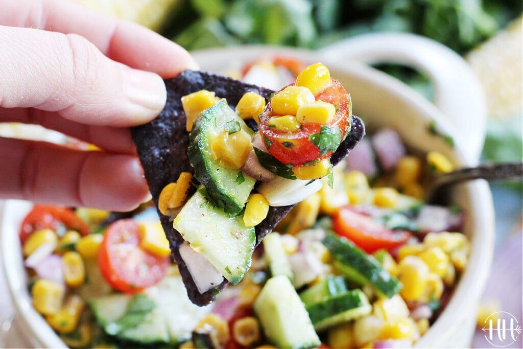 Roasted Corn and Cucumber Salsa on a blue corn tortilla chip!