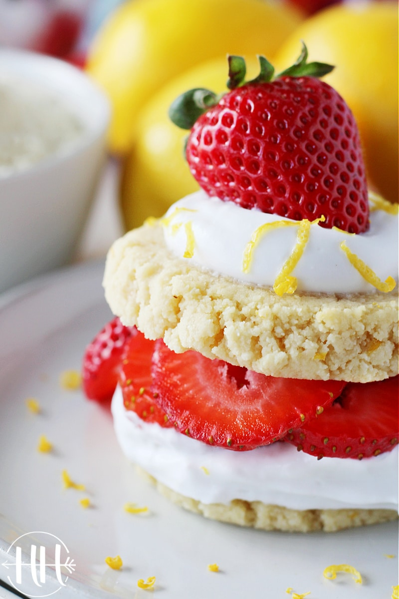 Shortbread cookies, strawberries, lemon zest, and coconut whipped cream layered beautifully.