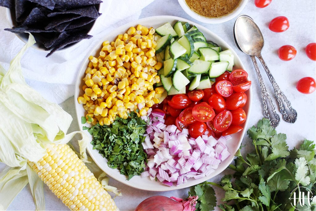 A beautiful bowl of summer vegetables ready to be mixed for a fresh healthy salsa!