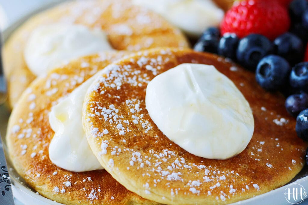 Dollop of Greek yogurt on protein pancakes.