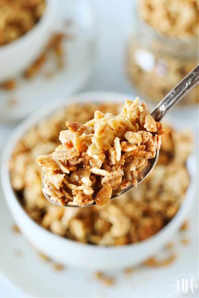 Up close photo of a spoonful of homemade granola and almond milk.